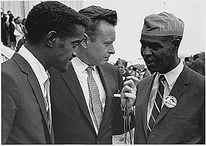 Roy Wilkins - Wilkins (right) with Sammy Davis, Jr. (left) and a reporter at the 1963. Civil Rights March on Washington, D.C.