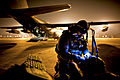 Defense.gov News Photo 110316-F-NW653-101 - U.S. Air Force Tech. Sgt. Ray Decker prepares his rucksack before boarding an MC-130P Combat Shadow in Sendai Japan on March 16 2011. Decker is.jpg