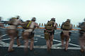 Defense.gov News Photo 120309-M-FW664-049 - Marines with the 11th Marine Expeditionary Unit s maritime raid force walk toward targets before firing aboard the amphibious transport dock USS.jpg