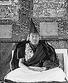 Detail, The 13th Dalai Lama of Tibet sitting on a throne at Norbulingka in 1921 (cropped).jpg