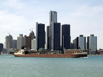 Great Lakes region - An upbound lake freighter passing the Detroit riverfront including the Renaissance Center.