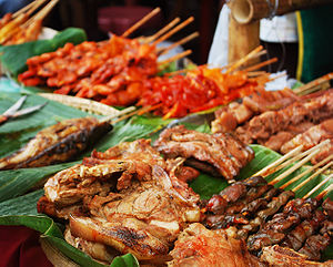 Dinagyang - Meat being sold on one of the many food stalls lined in the streets
