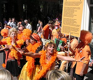 Principality of Orange - People dressed in orange in Amsterdam during Queen's Day in 2007