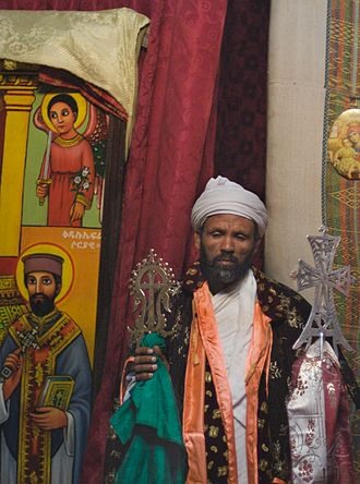 Blessing cross - An Ethiopian Orthodox bishop holding blessing and processional crosses.