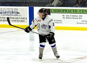 Southern Ontario Junior Hockey League - Dorchester Dolphins defenseman rushes back to defend against rush during 2013-14 season.