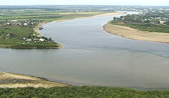 Northern Dvina River - Northern Dvina starts as the confluence of Yug River (on left) and Sukhona River (on top) near Veliky Ustyug (photo 2001)