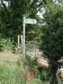 English public footpath sign and stile.tiff