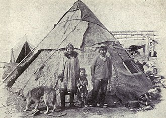 Alaskan Malamute - An Inupiat family with a Malamute from 1915.