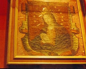 Our Lady of Guadalupe - The banner of conquistador Hernan Cortes from year 1521, which remained within the Archbishop's villa during the time of the Guadalupe apparitions, allegedly serving as inspiration for Marcos Cipac de Aquino's invention of the image. Note the disproportionate, uncentered hairline and separated little finger.