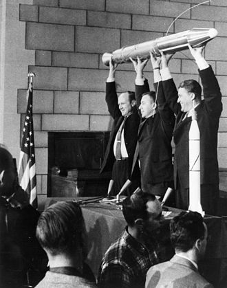 Explorer 1 - William Hayward Pickering, James Van Allen, and Wernher von Braun display a full-scale model of Explorer 1 at a crowded news conference in Washington, DC after confirmation the satellite was in orbit.