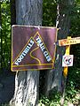 FLT CT08 5.2 mi - Foothills and Conservation Trail signs at S entrance Darien Lake S. P. - panoramio.jpg