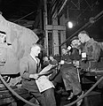 Factory workers on a lunch break beside the Matilda II tank they are constructing, 1942. D9194.jpg
