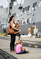 Family members watch from the pier as the guided-missile destroyer USS Michael Murphy (DDG 112) leaves Joint Base Pearl Harbor-Hickam, Hawaii, for an independent deployment to the western Pacific Ocean Oct. 20 141020-N-QG393-063.jpg