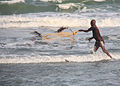 Fisher with a castingnet Gambia.jpg