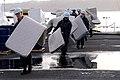 Flickr - Official U.S. Navy Imagery - Sailors move mattresses across the flight deck..jpg