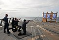Flickr - Official U.S. Navy Imagery - Sailors qualify with pistols at sea..jpg