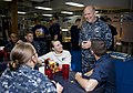 Flickr - Official U.S. Navy Imagery - The CO of USS Abraham Lincoln talks to a group of Sailors during a celebratory dinner for Abraham Lincoln Sailors whose birthdays are in the month of May..jpg