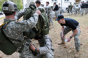 United States Army Jumpmaster School - An instructor from the USASOC Jumpmaster School's MTT evaluating a student performing JMPI