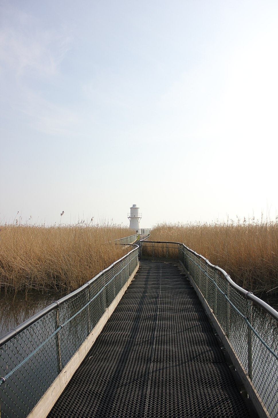 Floating walkway with lighthouse in background at Newport Wetlands Centre
