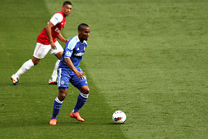 Florent Malouda - Malouda in action against Arsenal's Alex Oxlade-Chamberlain