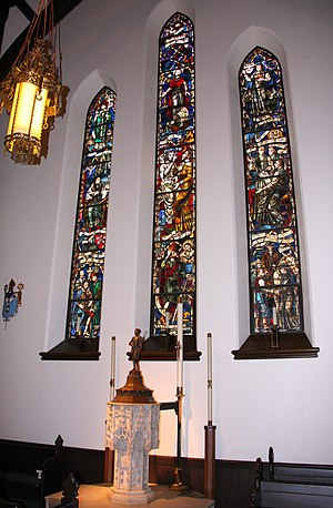 Christ Church Cathedral (Indianapolis) - Baptismal font and windows depicting church history on the north side of the church