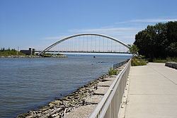 The Humber River as it exits into Lake Ontario with the Humber Bay Arch Bridge prominent in the background.