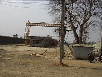 Second Thai–Lao Friendship Bridge - Box girder sections being constructed, and a completed box girder span almost completed on left of photo
