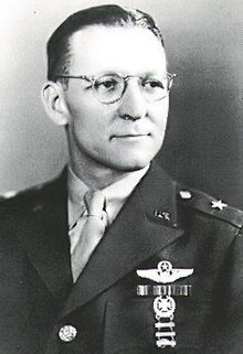 Head and shoulders view of man in military uniform with decorations