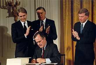 William K. Reilly - William Reilly watches as President George H.W. Bush signs the Clean Air Act Amendments of 1990