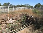Langlaagte lies about eleven kilometres from the centre of Johannesburg. In a memorial park adjoining the Main Reef Road one may still see the excavations on the claims of the discoverers of the Main Reef Group of Conglomerates of the Witwatersrand.