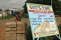 God's Time Bakery - Street Sign with Passerby - Bolgatanga - Ghana (4776559593).jpg