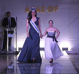ddfa11f4 Chhillar walks the ramp alongside a person with Down Syndrome at the APAE  Charity Gala, in Brasília