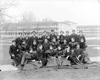 external image 325px-Group_of_Male_and_Female_Students%3B_Brick_Dormitories_And_Bandstand_in_Background_1879.jpg