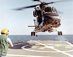 HH-2D Seasprite approaches USS W.S. Sims (DE-1059) during flight deck strength tests in September 1970.jpg