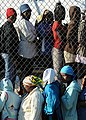 Haitian women stand in line to receive food distributed by the Irish non-governmental organization GOAL in Kenscoff, Haiti, Feb. 20, 2010 100220-N-HX866-002.jpg