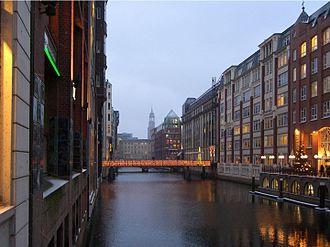 Neustadt, Hamburg - Bleichenfleet, one of the canals in Neustadt.  In the background, the tower of St. Michaelis.