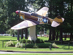 A replica Curtiss P-40 Warhawk on static display at Hanscom AFB.