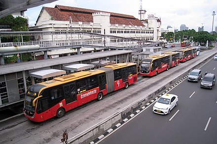 TransJakarta in Jakarta, Indonesia. With a length of 251.2 km (2019), it has the longest BRT system in the world. Harmoni Central Busway Transjakarta 1.JPG