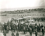 Harvey Crawford and biplane at Tacoma 1912.jpg