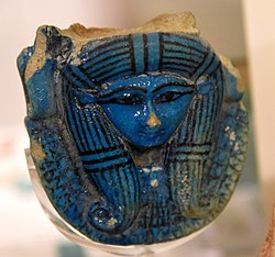 Hathor's head. Faience, from a sistrum's handle. 18th Dynasty. From Thebes, Egypt. The Petrie Museum of Egyptian Archaeology, London.jpg