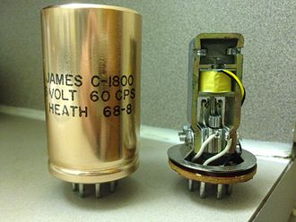 Vibrator (electronic) - A pair of Heathkit-brand vibrators manufactured by James Electronics, with octal bases. The one on the right has been stripped of the aluminum cap so the inner components can be seen.