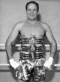 Henry Cooper showing off 3 lonsdale belts.png