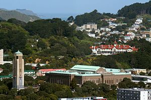 National War Memorial (New Zealand) - Landscape showing the National War Memorial (New Zealand) (Carillon lower left), New Zealand Dominion Museum building (copper-roofed building lower middle and lower right), Government House, Wellington (Edwardian building right middle) and Baring Head Lighthouse (on ridge upper left in far distance).