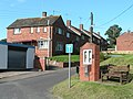 Houses in Clyst Honiton, next to the church noticeboard - geograph.org.uk - 1435135.jpg