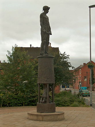 Hucknall - Bronze statue commemorating the 'lost' mining industry seen on the way from Hucknall tram and railway station into the town. The main figure is on top of a Davy lamp, whilst another collier is depicted hewing coal 'inside' the lamp 'glass'.