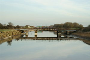 River Huntspill - The Huntspill river crossed by a railway bridge and the M5 motorway