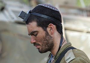 Kippah - IDF soldier Asael Lubotzky prays with Kippah.