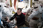 ISS-55 Ricky Arnold and Scott Tingle scrub EMUs in the Quest airlock (2).jpg