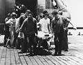 Injured crewman from USS Forrestal (CVA-59) is brought to USS Oriskany (CVA-34) with USAF HH-3E in 1967.jpg