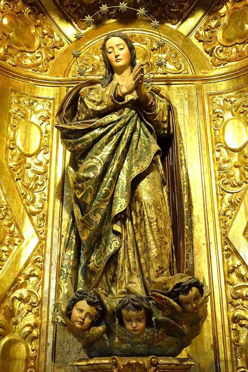 https://upload.wikimedia.org/wikipedia/commons/thumb/0/03/Inmaculada_-_Cathedral_of_Seville_-_Sevilla%2C_Spain_-_DSC07585.jpg/800px-Inmaculada_-_Cathedral_of_Seville_-_Sevilla%2C_Spain_-_DSC07585.jpg